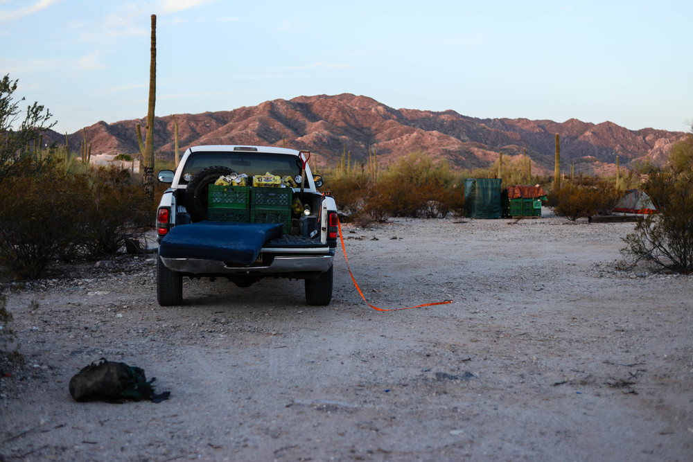 Each day the truck must be loaded with water, food, and medical supplies before entering remote, nearly inaccessible roads in the desert. At 6am it is 103 degrees in Ajo, AZ.