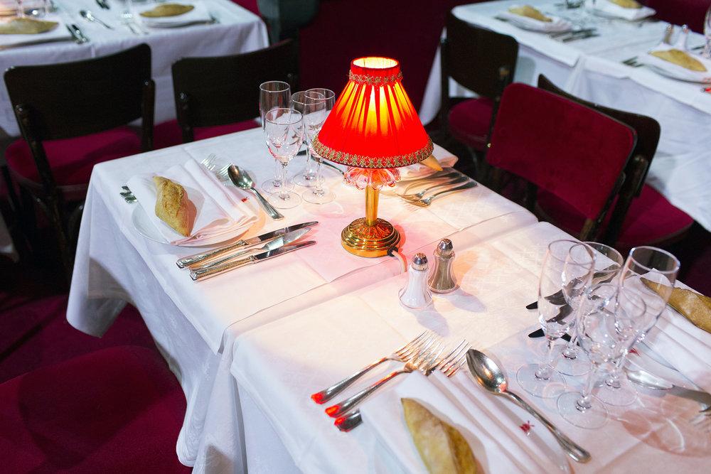 Moulin Rouge dinner setting for Expert Journeys