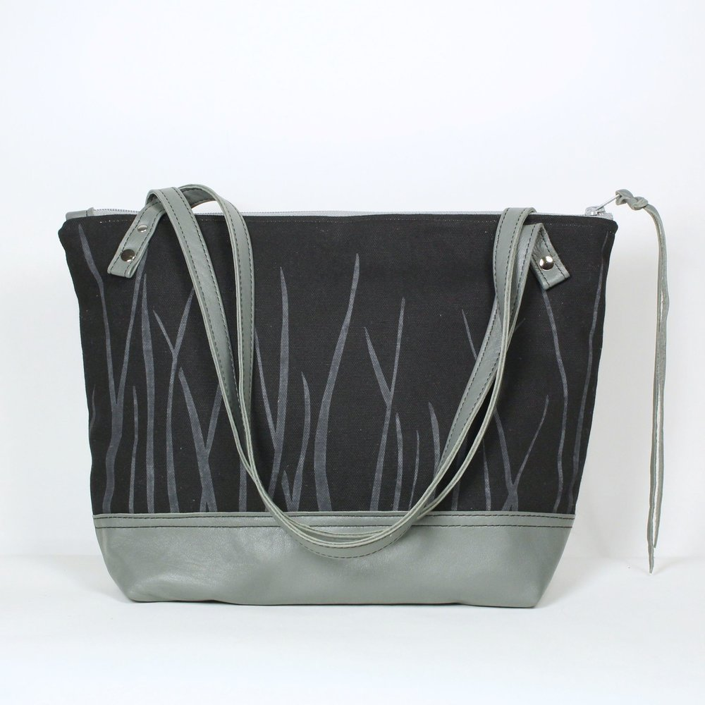 'Gretel' Small zippered tote bag in black cotton with grasses print, leather base and strap