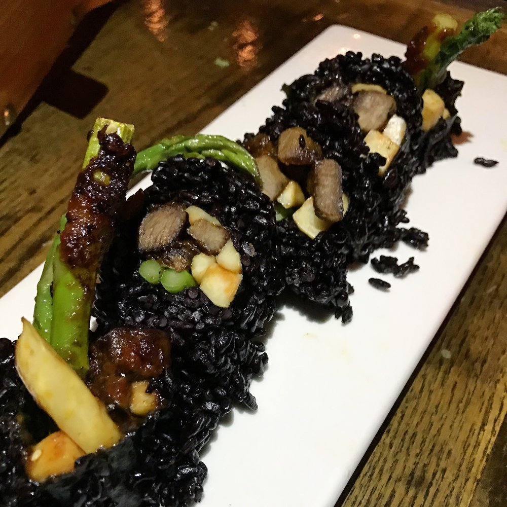 Forbidden Roll: black rice, wagyu beef teriyaki, asparagus, and king mushroom