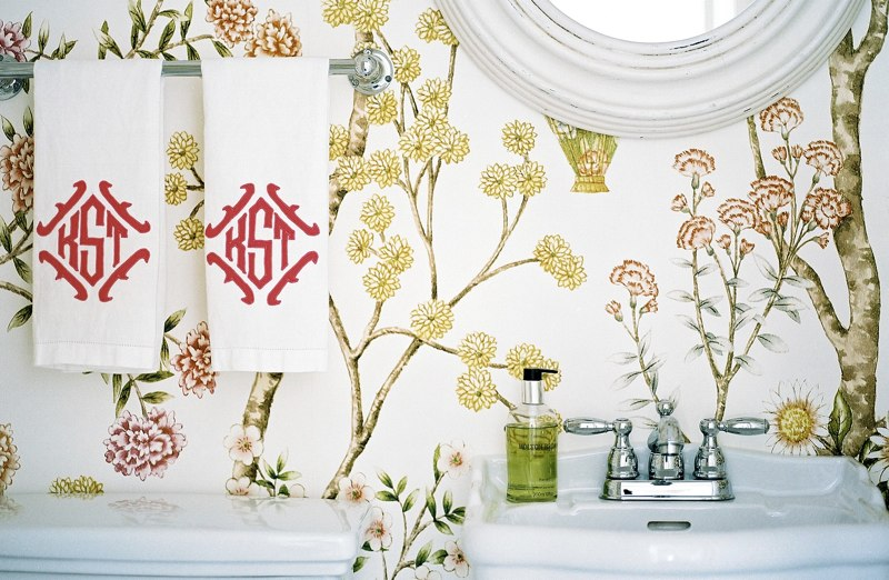 yellow flower wallpaper, white mirror, monogrammed towels
