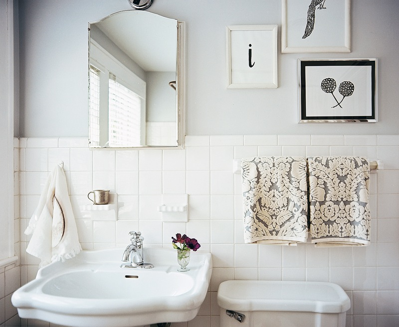 white bathroom with framed art