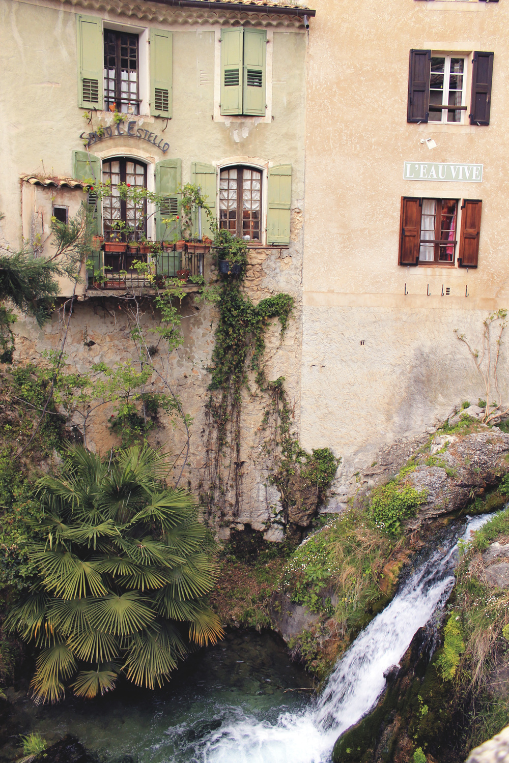 waterfall town france mountain palm tree flowers windowsill