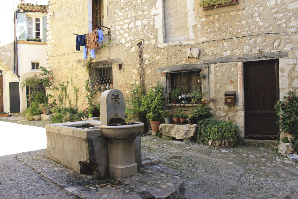 saint paul de vence france courtyard square fountain plants stone