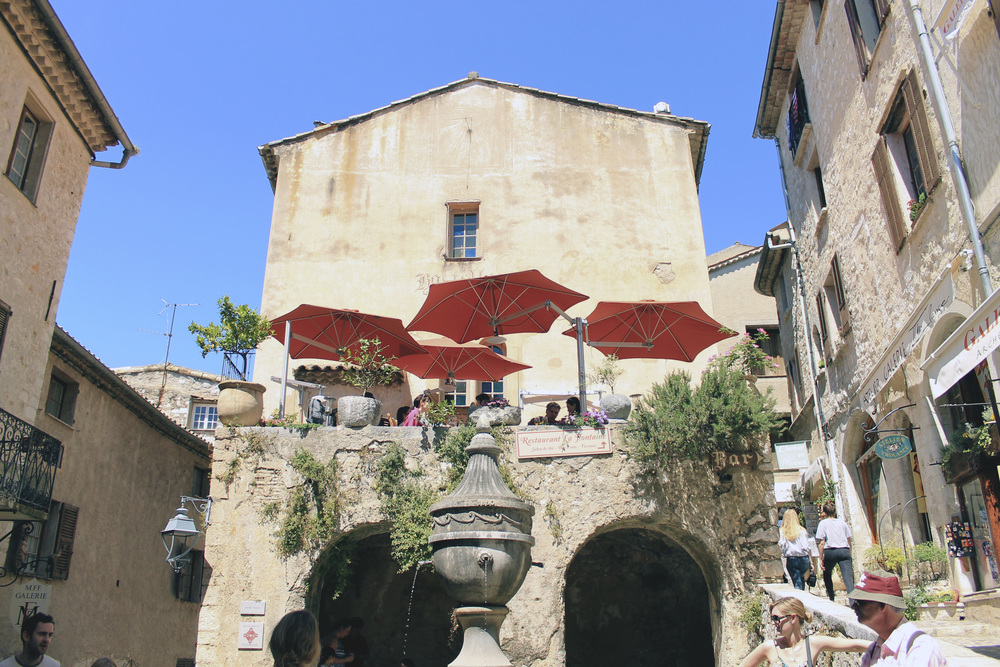 saint paul de vence terrace patio umbrellas red