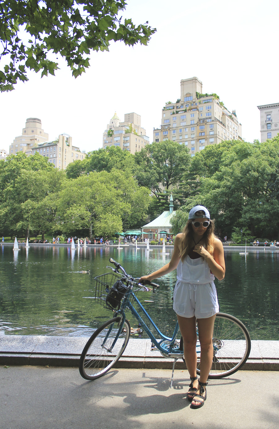 central park upper east side overalls backwards cap bike