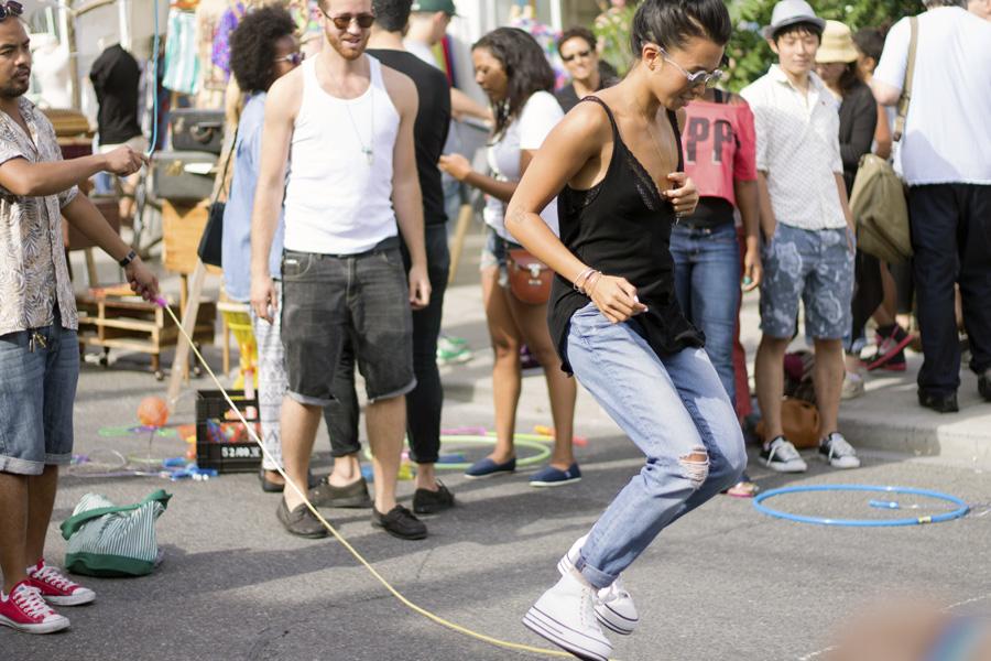 girl platform boyfriend jeans black tank skipping