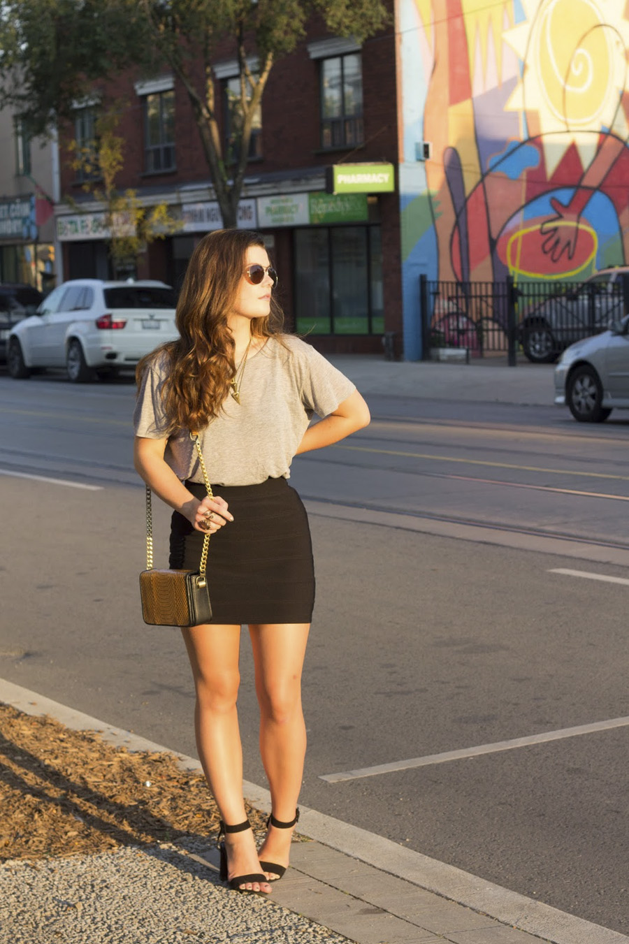 grey tee tucked black miniskirt