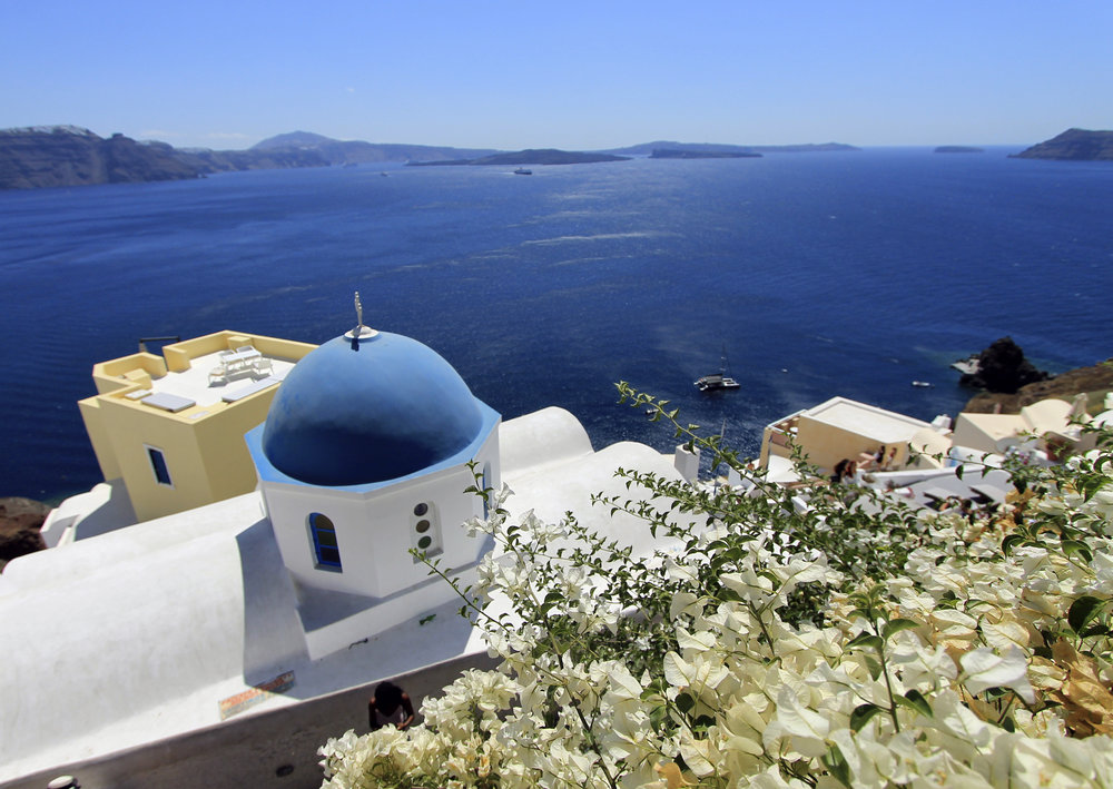 blue white church oia santorini views flowers travel.jpg