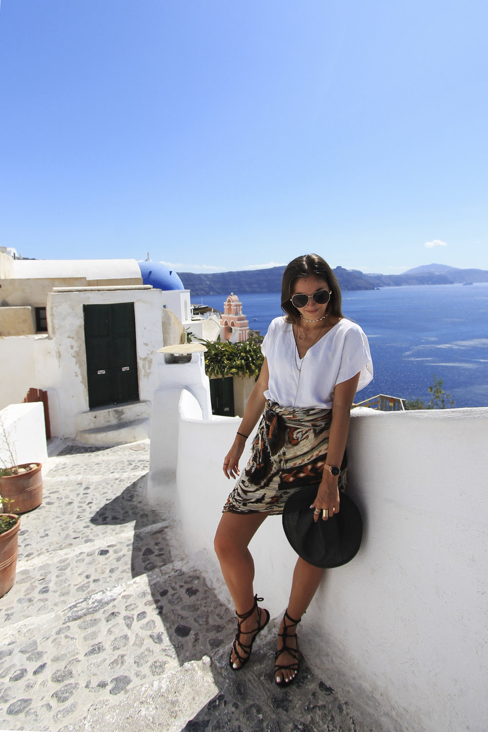 oia santorini travel style outfit tribal skirt white tee black hat sandals lace up.jpg