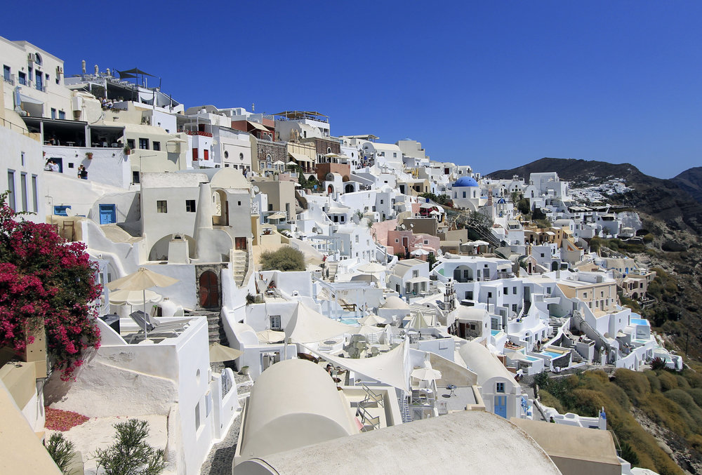 oia santorini views houses white greece travel summer.jpg