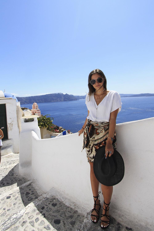 wrap scarf skirt style white tee santorini oia travel outfit blogger.jpg