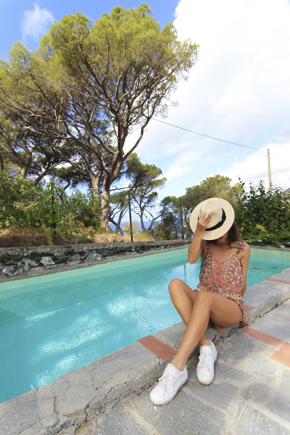 levanto italy airbnb pool fashion blogger romper.jpg