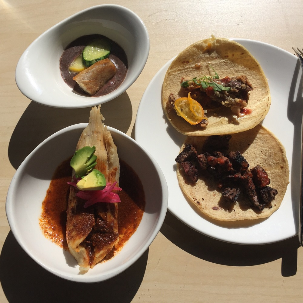 Top Left: Mexican Sea Bass with black been puree; Bottom Left: Lamb Birra Tamale; On the plate: Top: Duck Carnitas Taco and bottom: Grilled Hangar Stack Taco