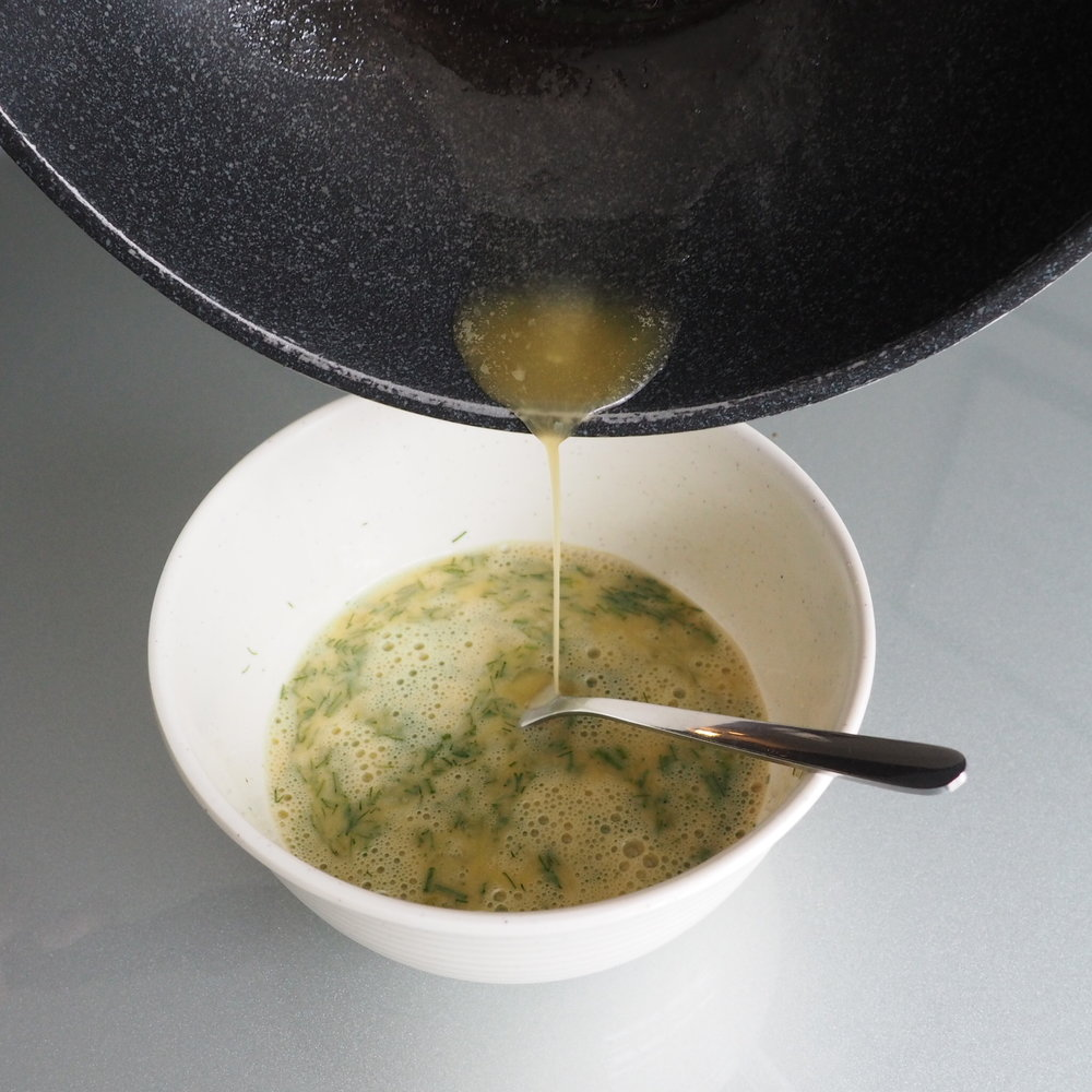 Step 2: Add in 1 tsp of melted vegan butter or oil into your scrambled eggs