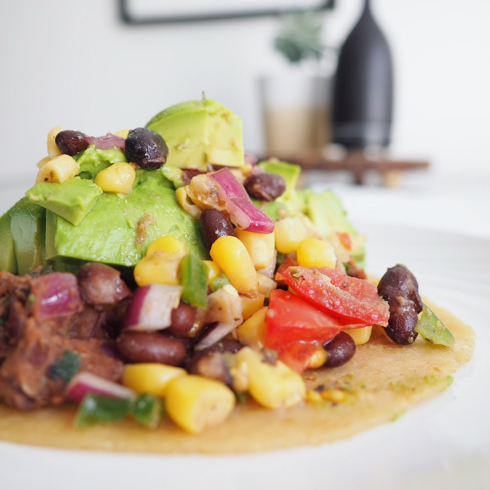 Using my black bean dip, I added it to a warmed tortilla as the base along with some corn-bean salad and diced avocado. It was delicious!
