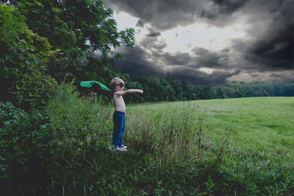 """""""A mini super hero under storm clouds""""   Www.facebook.com/photosbyjoyce3"""
