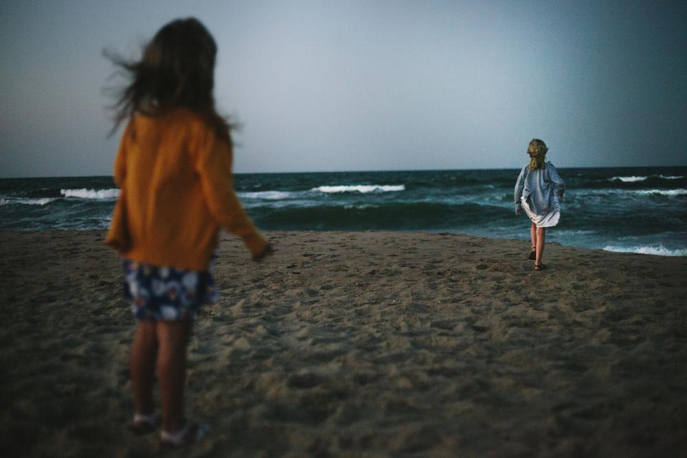 greta on beach walking away.jpg