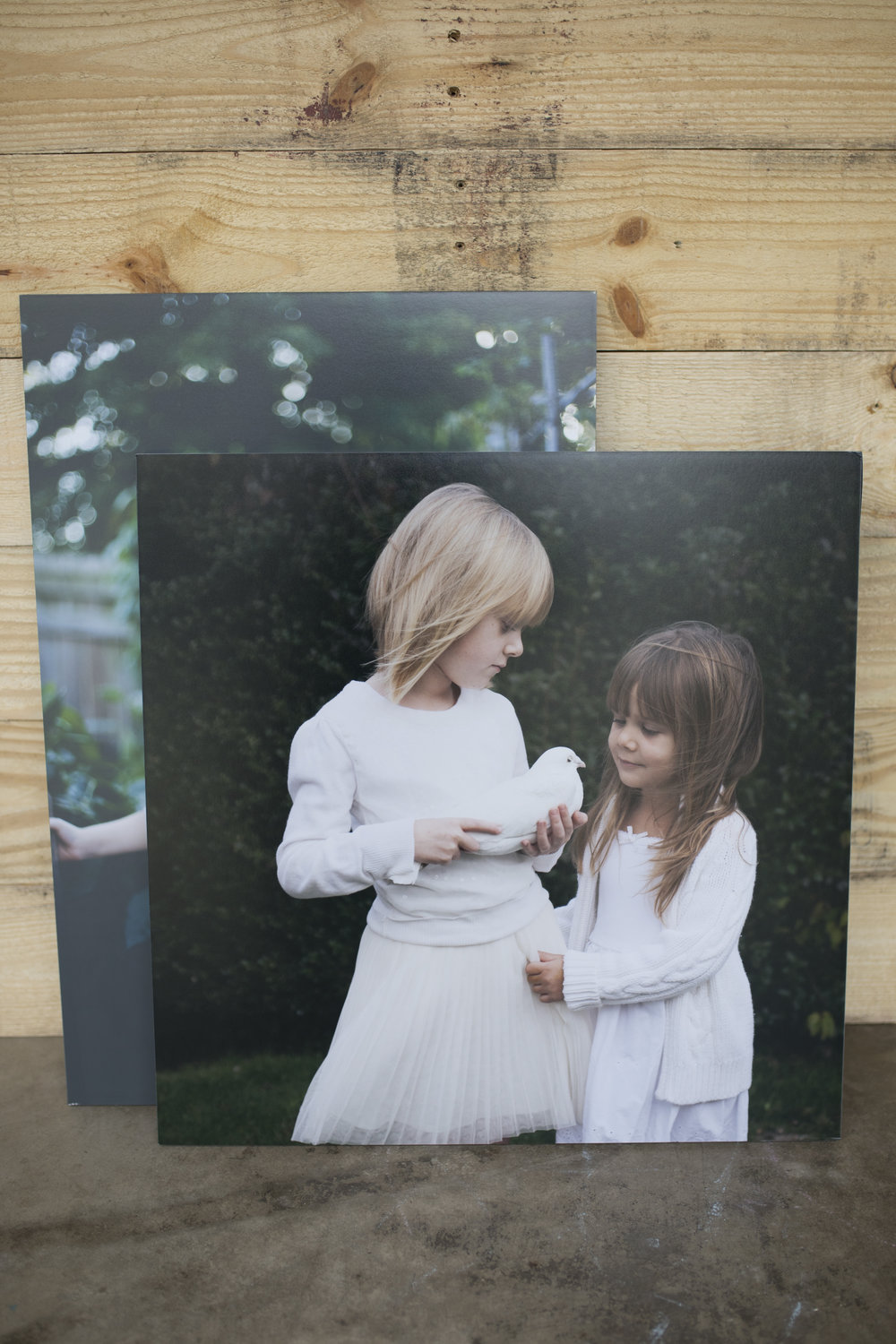 Easy to love.. - Standouts are one of the most popular options because of their clean edge, crisp images, and lightweight boards. Even large images like these in 24x36 are easily hung.
