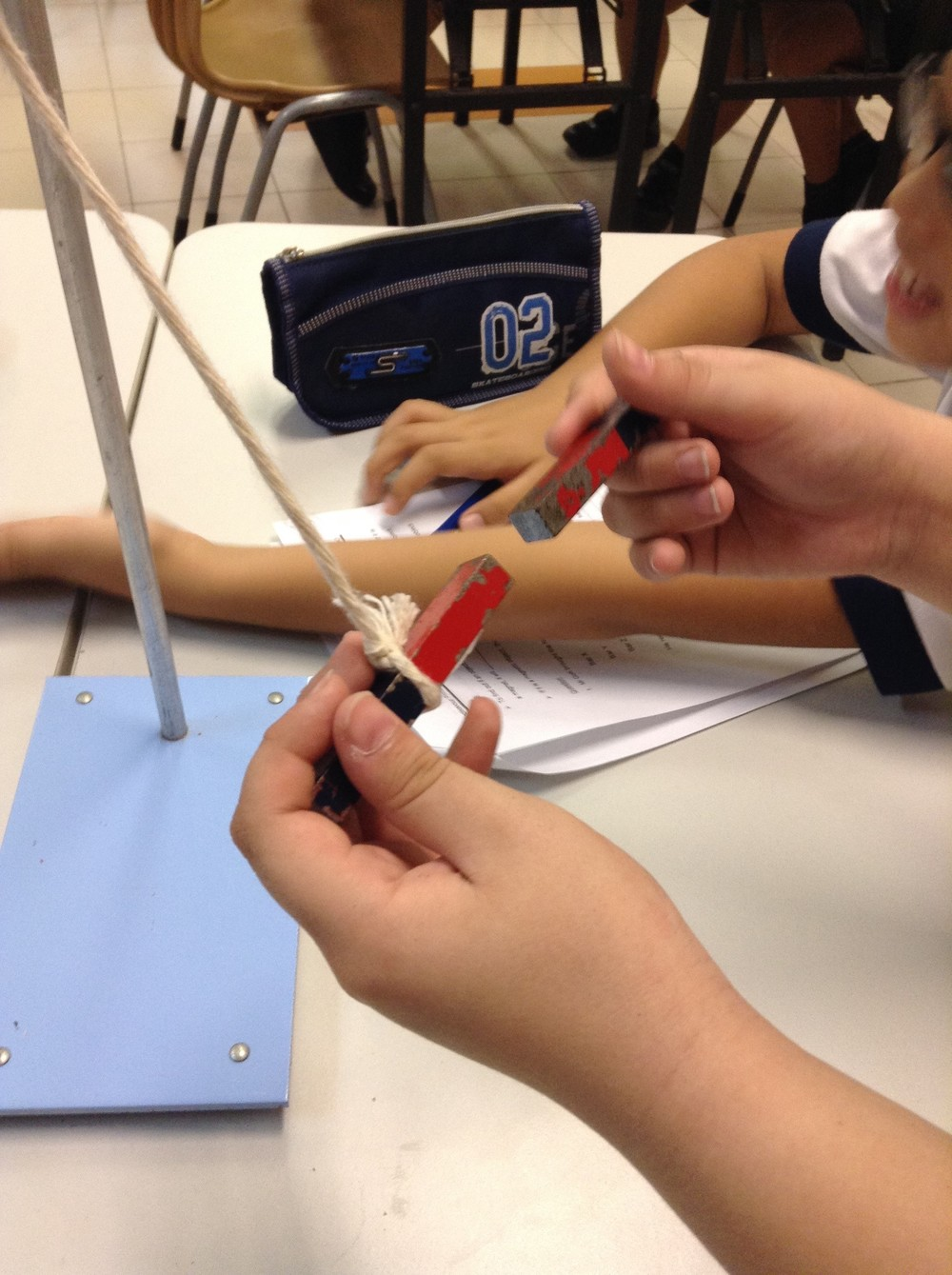 Fig 1. Students conducting the experiment.