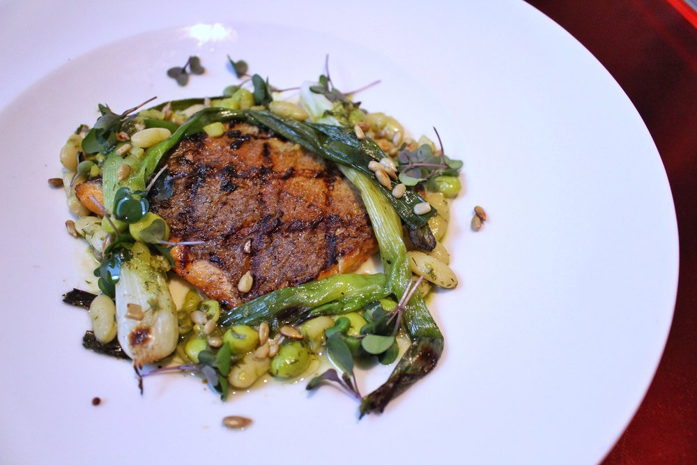 Grilled Trout  - charred green onions, white bean, dill pesto, toasted sunflower seeds, artichoke and cultured cream puree