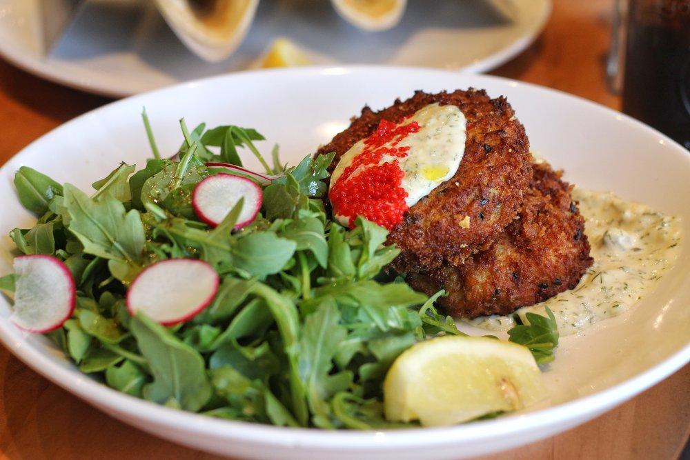 Seafood Cakes  – blue crab, tiger shrimp, arugula salad, caviar, tartar sauce