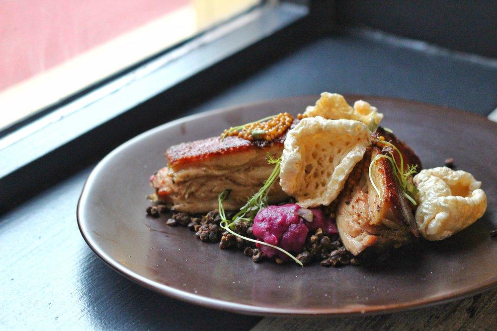 Suckling Pig  – braised lentils, sauerkraut puree, chicharron pickled mustard seeds