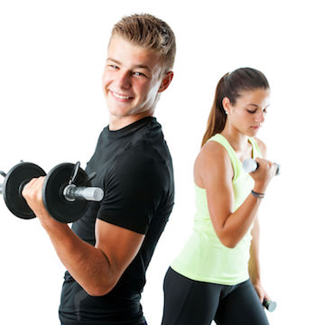 44242804 - close up portrait of handsome teen boy working out with weights.out of focus girl working out in background.isolated on white.