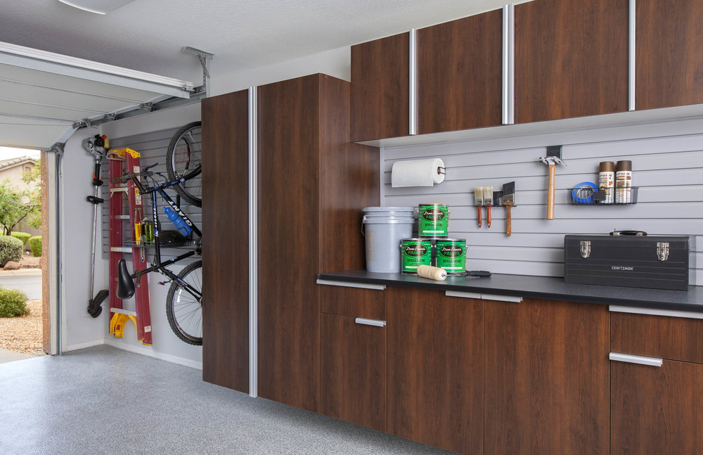 These Coco garage cabinets add a bit of warmth and color to this gray toned garage.