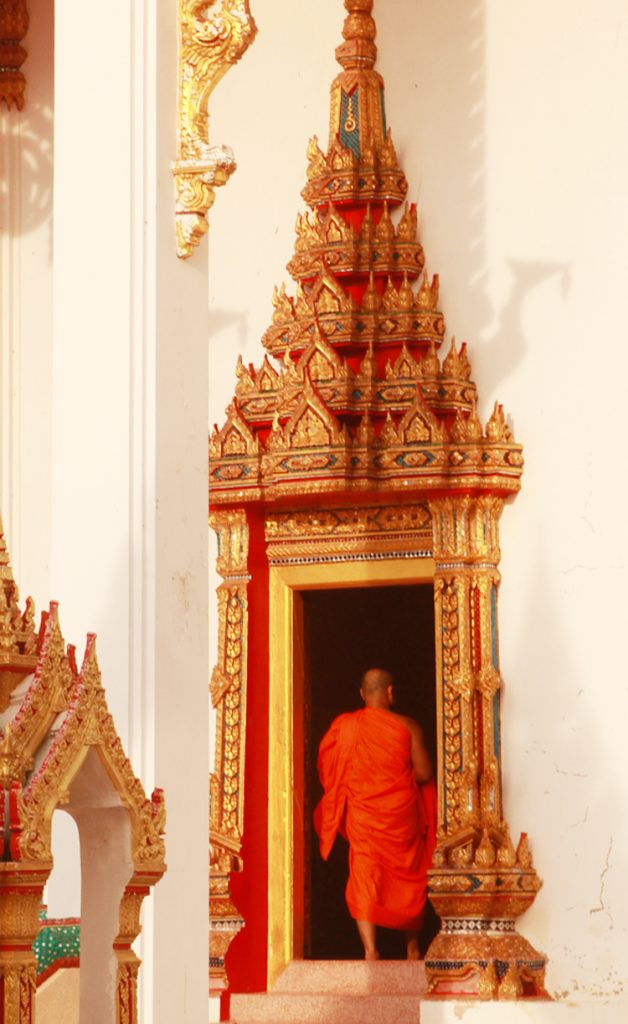Buddhist monk walking into the temple.