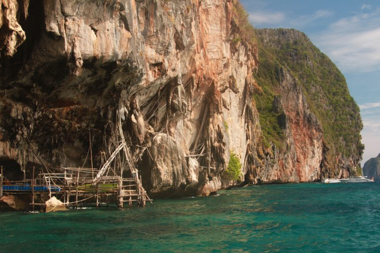 Vikings Cave, where Thai men climb the cliffs to get birds nest (made out of saliva, not grass)