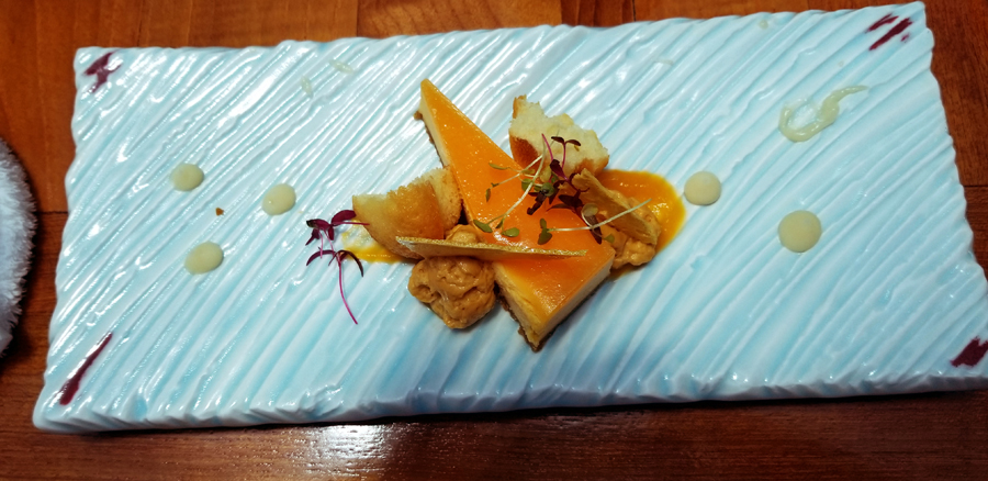 How they served the food on artistic pottery. This is the pumpkin cheesecake dessert.