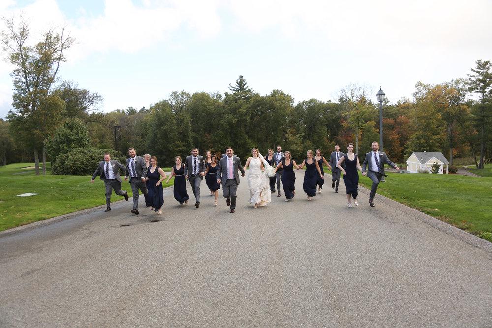 Wedding party running photos Boston MA