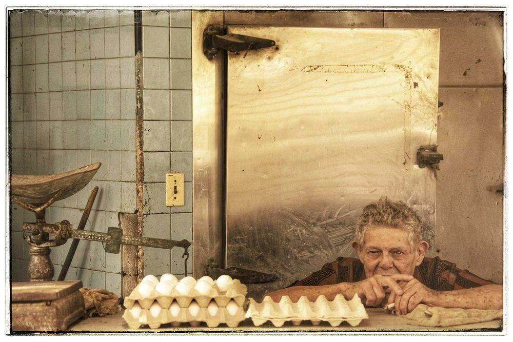 The egg vendor. Many people in Cuba smoke cigarettes.