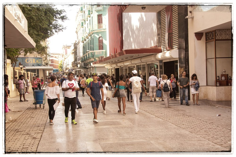 This is the main shopping boulevard, where many cruise ship passengers hang out.