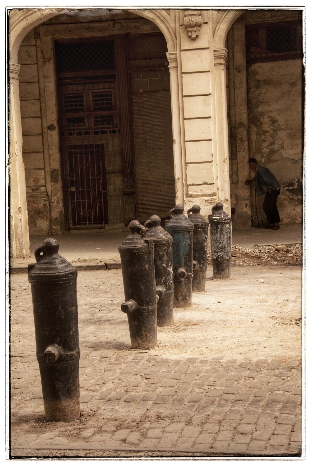 They use old canons as street barriers.