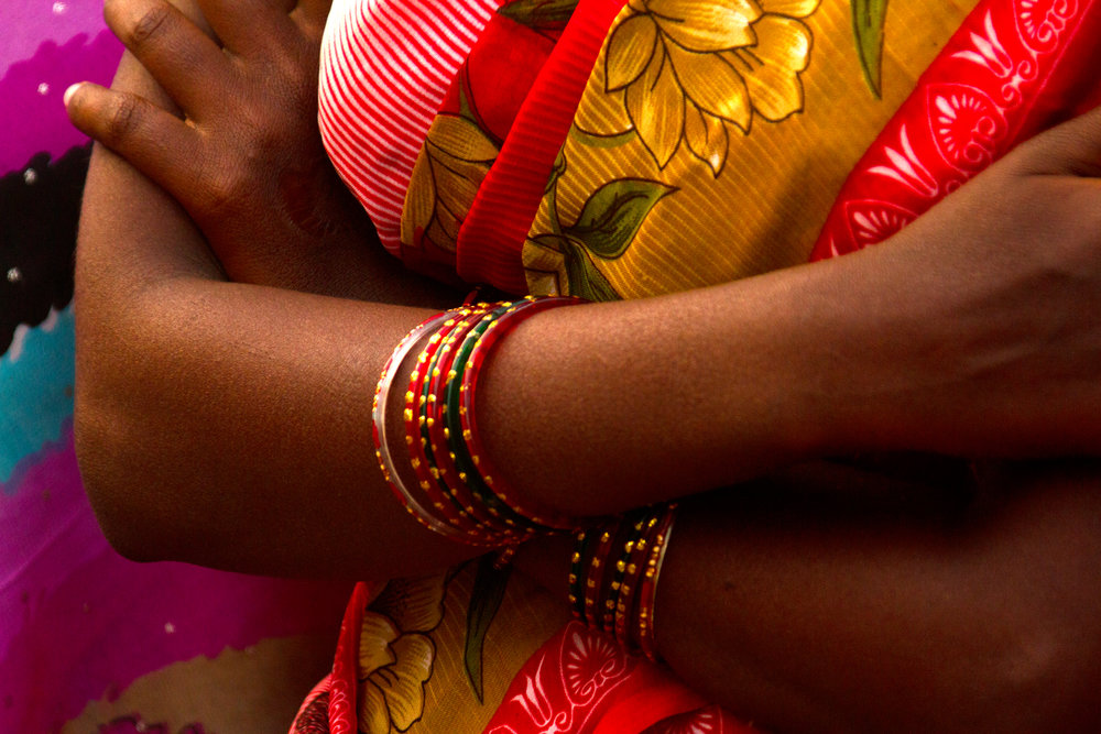 Colorful Saris sarees in India arms and bracelets travel photos