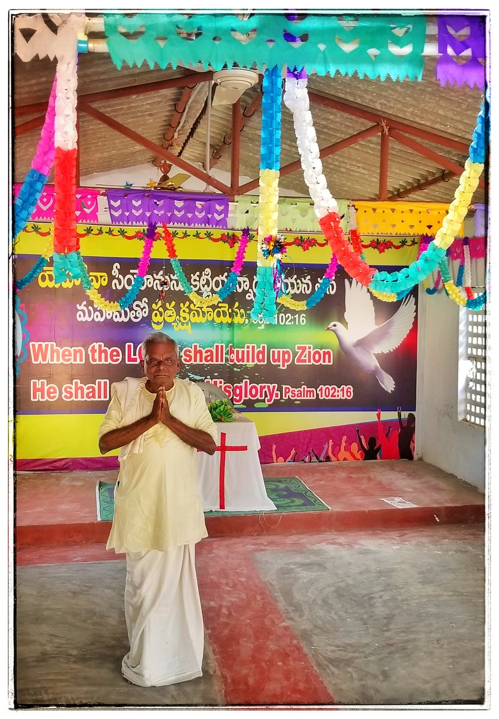 Indian Christian pastor and his colorful church in India. All the churches were vibrant.
