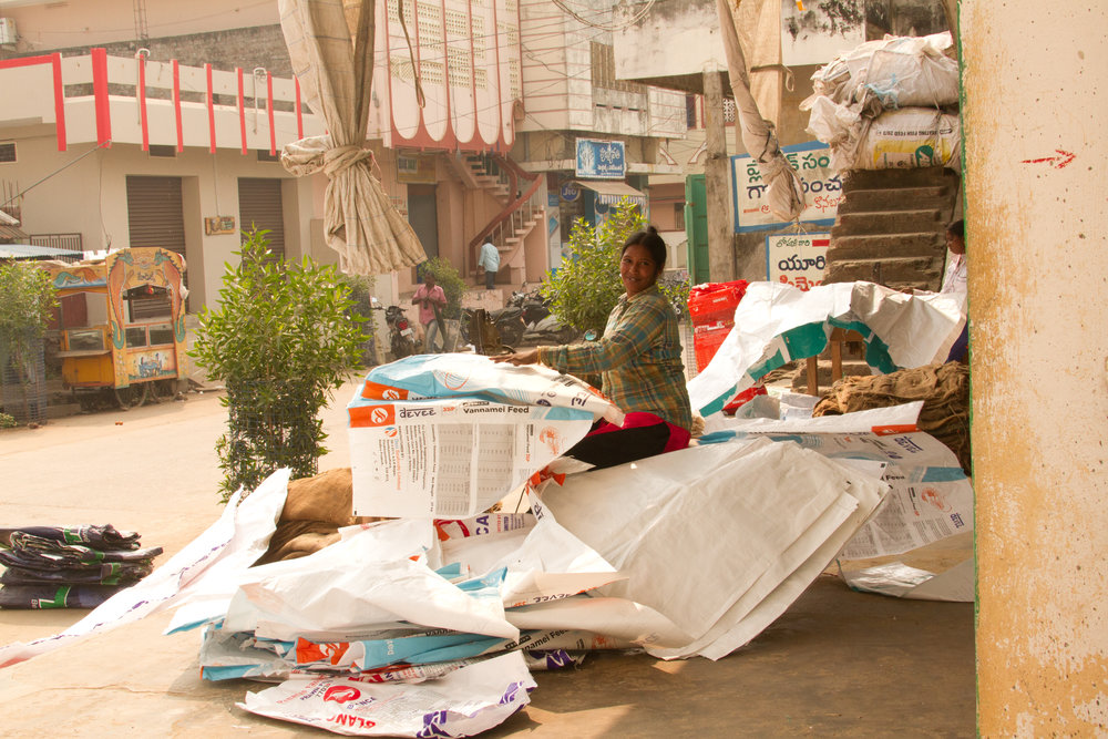Woman making plastic bags.