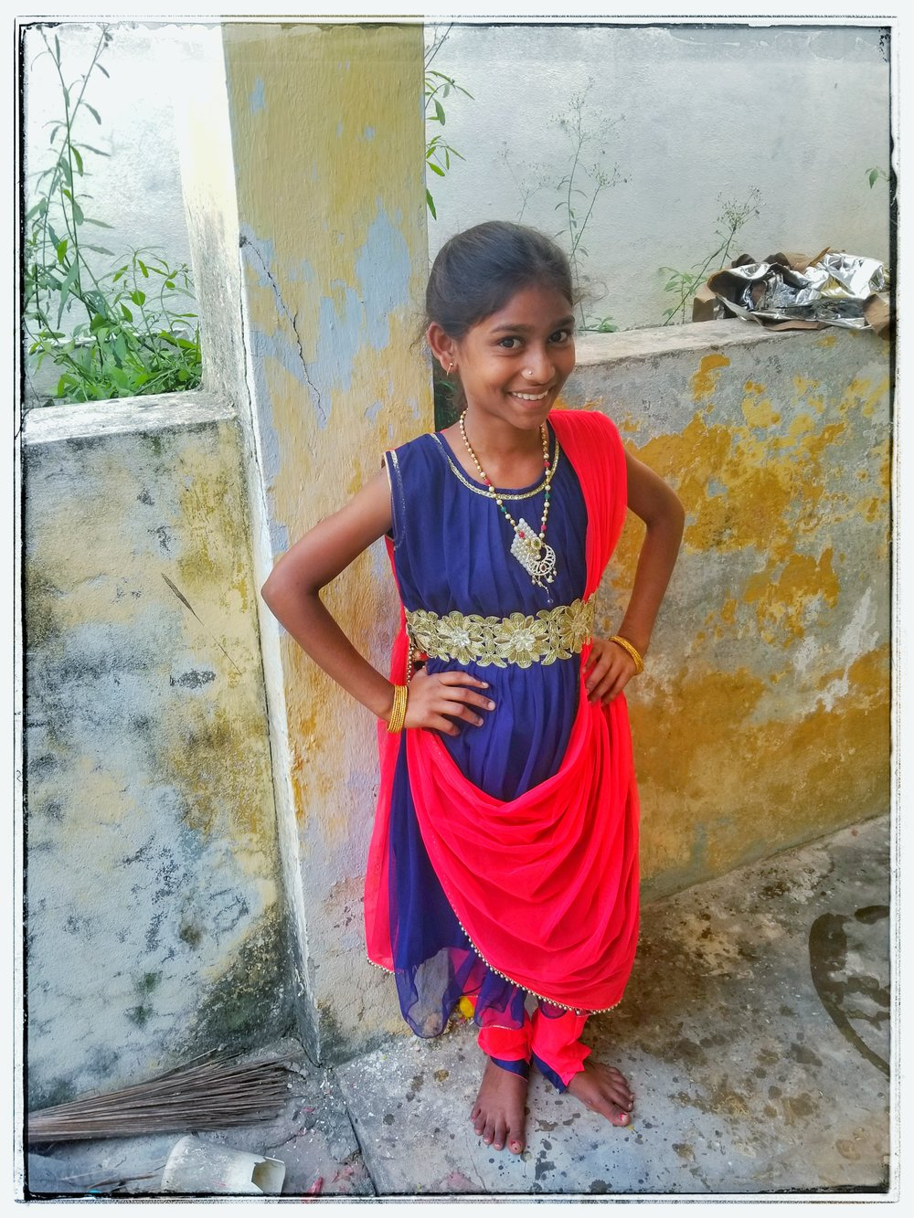 Orphan girl in India with saree.