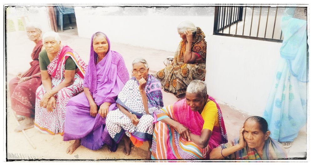 Widows outside the church.