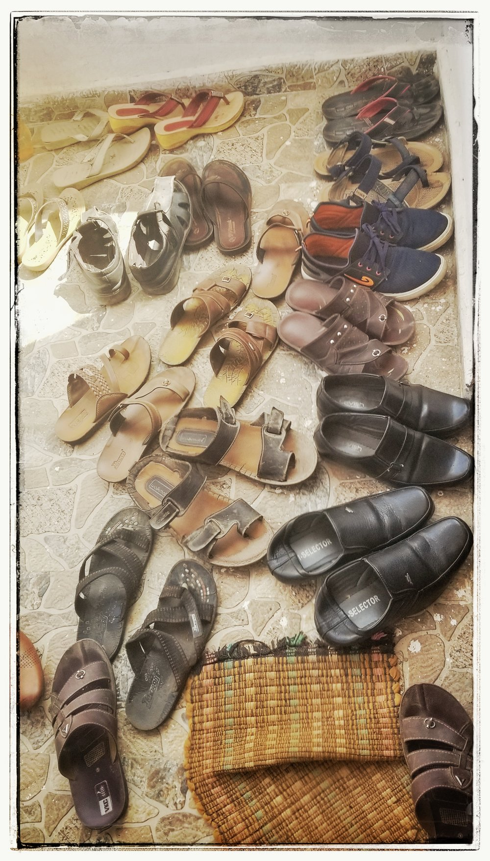 Shoes are always removed not just for churches or mosques/temples but in homes as well as a sign of respect.