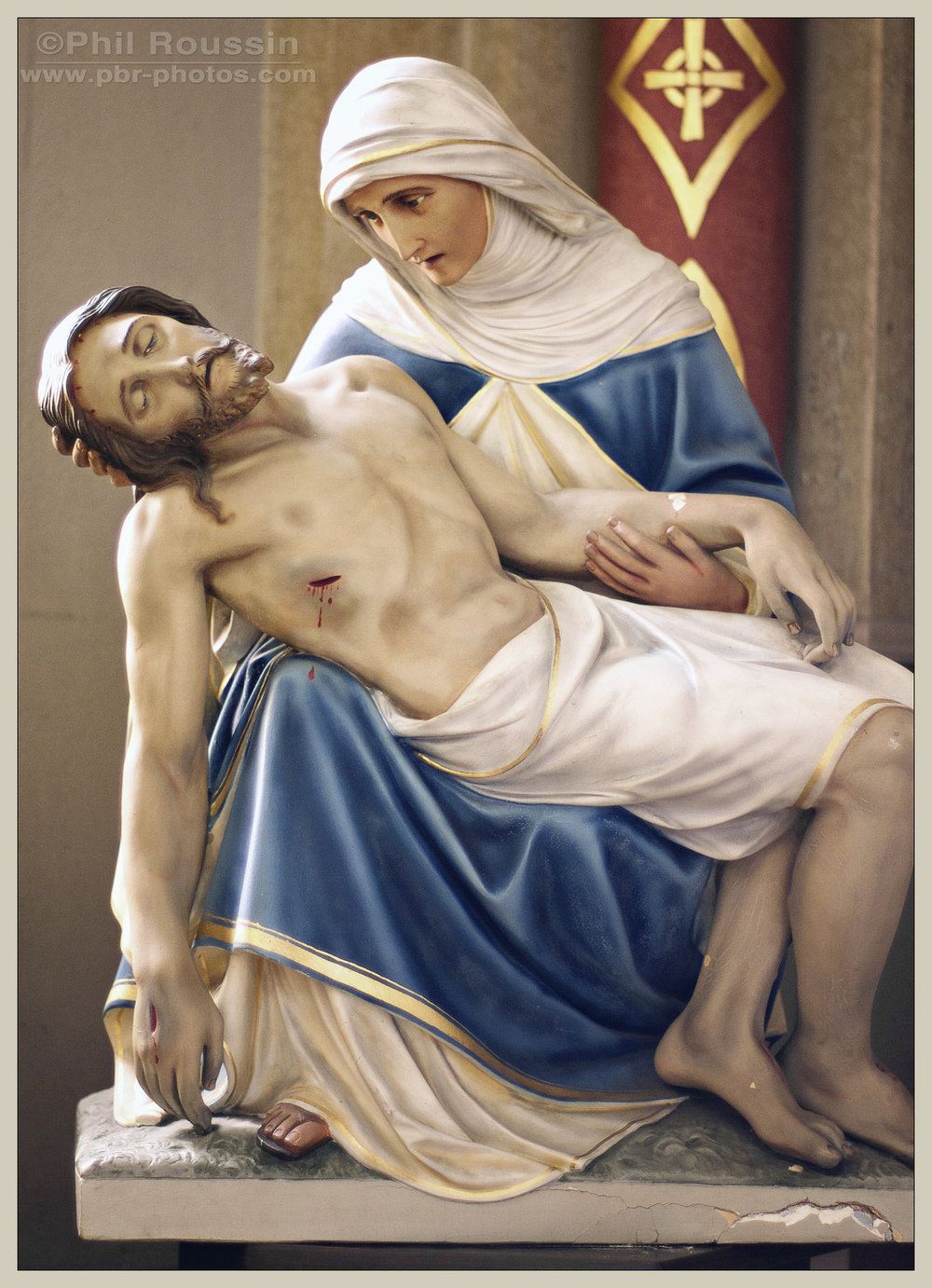 The Pieta is next to the Infant of Prague Altar in the South transept.