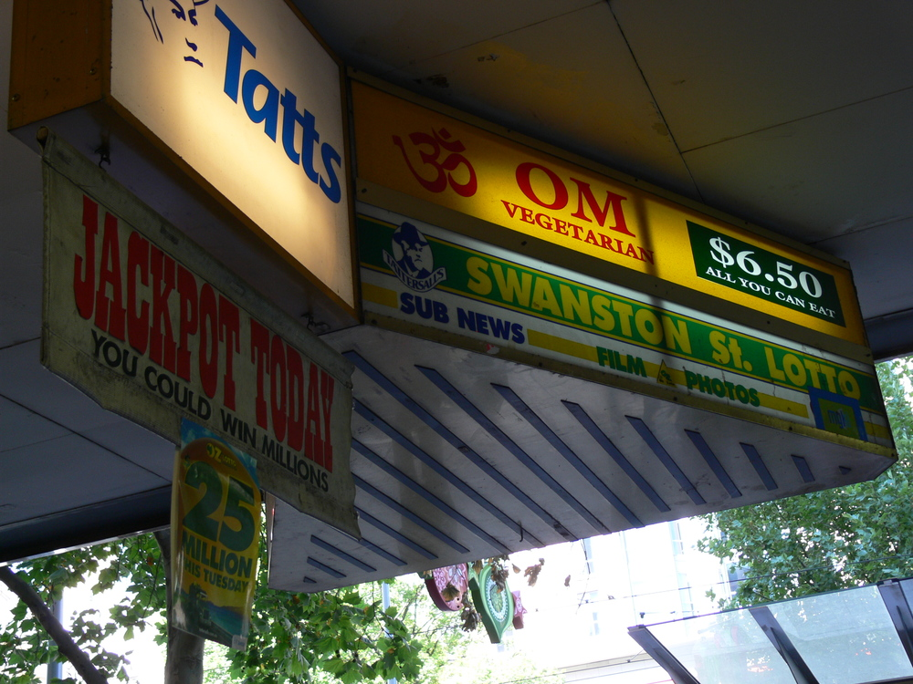 OM Vegetarian Wales Arcade Sign visible from Swanston St (opposite the tram stops)