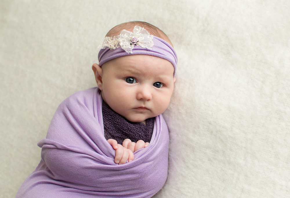 October-2016-Tabatha-Sue-Photography-Best-baby-photographer-in-parma-ohio-near-cleveland-ohio-baby-in-purple-headband-and-wrap-professional-home-studio-in-44130.png