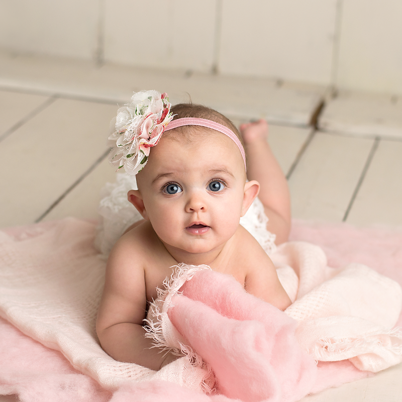 milestone-6-month-session-in-parma-heights-ohio-best-baby-photographer-in-northeast-ohio-home-studio-professional-pink-fur-and-lace-diaper-cover.png