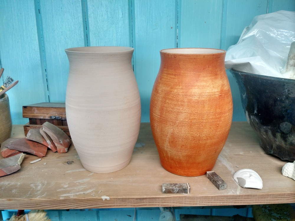 This is both vases after firing. You can see the terra sig has turned a random orange colour and kept some of the shine. I am pleased with the result, but I would like to make a piece from scratch, knowing that I will terra sig it later. That way I can make it as shiny as possible.