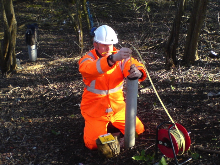 Manual measurements of settlement and heave in a railway embankment using a Geotechnical Observations' magnet extensometer. All measurements are checked before leaving site to ensure quality.