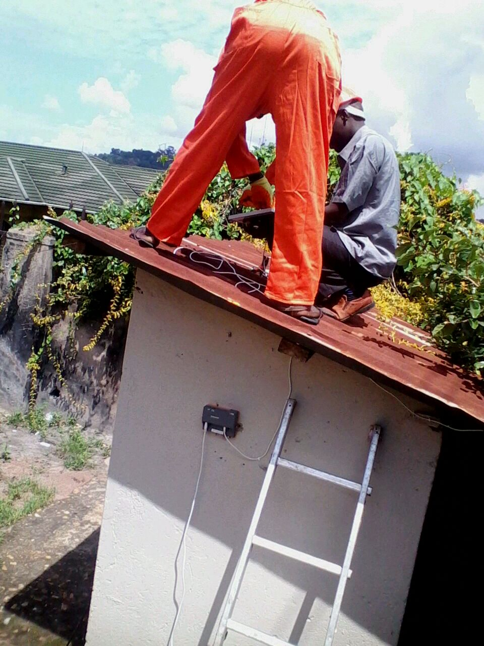 Learning soalr panel installation on the roof. At Barefoot Power..jpg