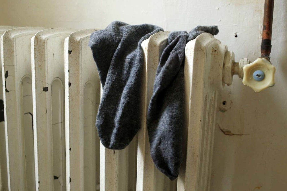 Socks on a radiator.